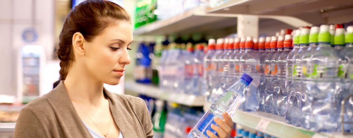 Woman looking at a plastic bottle