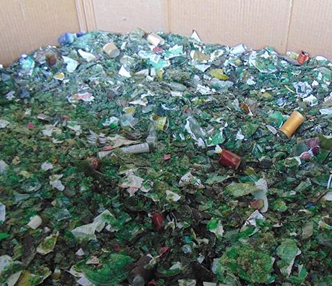 Large bin of broken glass